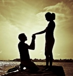 kneeling proposal in sunset. beautiful couple